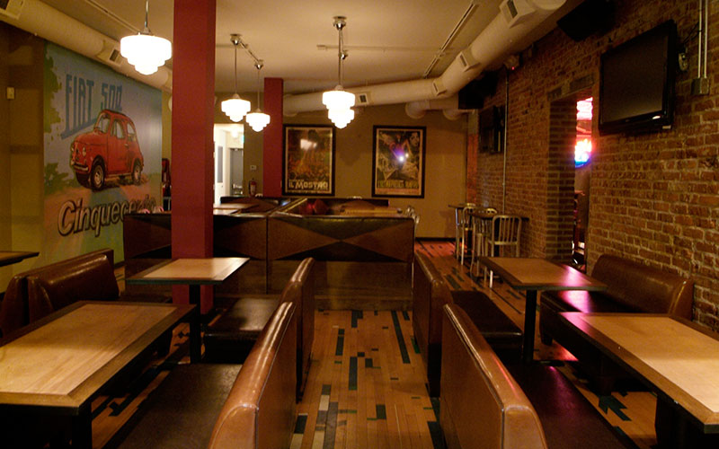 Custom Restaurant Interior Design, Found Objects, custom booths, graphics, Furniture Recycled, Time Period, Throwback, Denver, Colorado by ShikeDesign.com Interior design picture of Zio Romolos restaurant in Denver, Colorado
